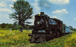 THE GOOD OLD DAYS - The old-time steam locomotive and railroad cars of another era recall the thrill of railroading. The Cadillac & Lake City Railway Company offers trips through Michigan's forests and along beautiful lakes on runs between Cadillac and Lake City, Michigan